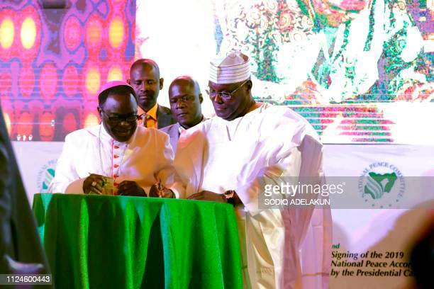 Peoples Democratic Party Nigerian presidential candidate Atiku Abubakar signs a document on February 13 during a meeting with the Nigerian president...