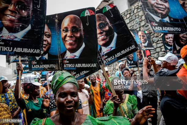 TOPSHOT People's Democratic Party supporters gather in Lagos' Tafawa Balewa Square where the official opposition PDP party is holding a rally on...