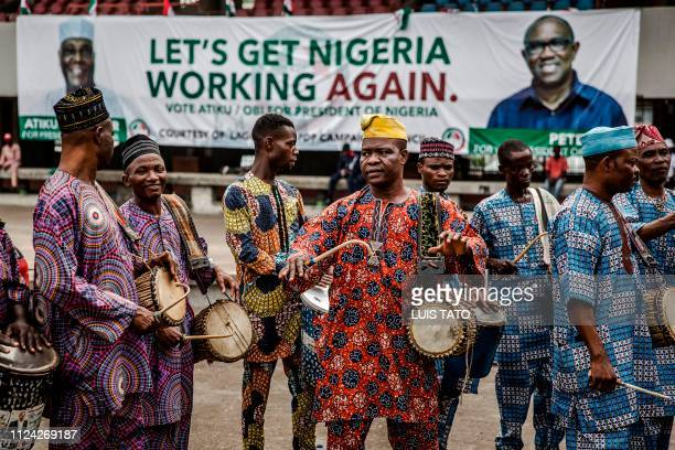 People's Democratic Party supporters gather in Lagos' Tafawa Balewa Square where the official opposition PDP party is holding a rally on February 12...