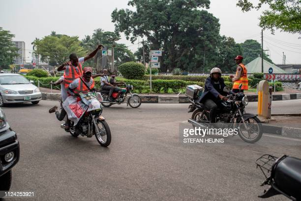 Peoples Democratic Party supporters ride their motorcycle to arrive at the Tafawa Balewa Square in Lagos where the official opposition PDP party will...