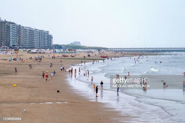 Peoples enjoying the beach and the sea in Blankenberge along the Belgian coast on August 15 as Europe experiences a heatwave. / Belgium OUT