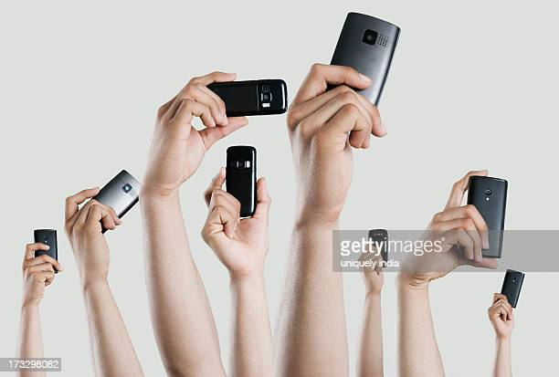 People's hands holding mobile phones