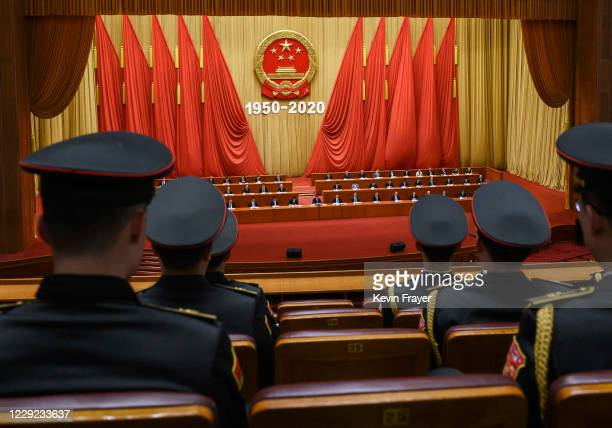 People's Liberation Army band members watch as Chinese President Xi Jinping, middle, and senior members attend a ceremony marking the 70th...
