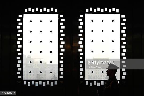 People's Liberation Army guard stands in front of door during the US Army Chief of Staff Gen Ray Odierno meeting with Fan Changlong Deputy Chaiman of...
