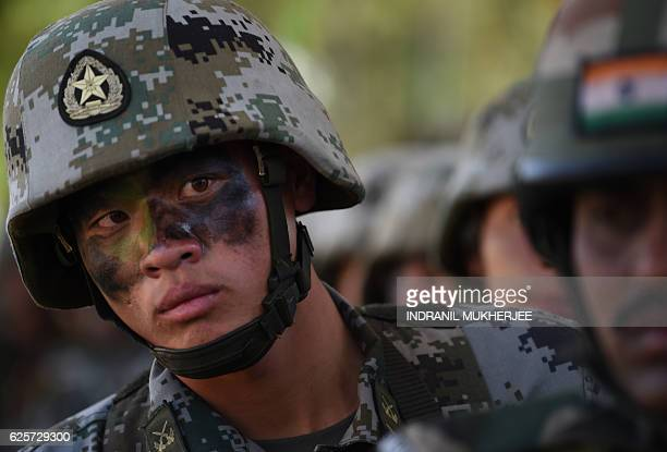 A People's Liberation Army of China soldier looks on after participating in an antiterror drill during the Sixth IndiaChina Joint Training exercise...