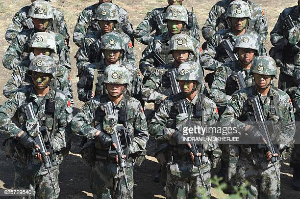 People's Liberation Army of China soldiers line up after participating in an antiterror drill during the Sixth IndiaChina Joint Training exercise...