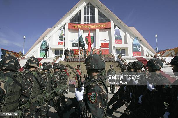 People's Liberation Army of China soldiers march past Pakistani and Chinese dignitaries during military exercises on December 18 2006 in Abbottabad...
