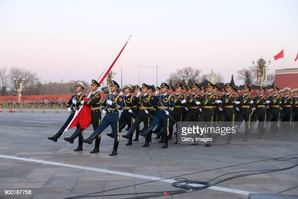 People's Liberation Army officers participate in the flagraising ceremony at Tian'anmen Square on January 1 2018 in Beijing China PLA guarded...