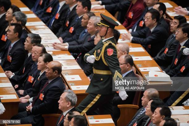 People's Liberation Army soldier prepares for China's President Xi Jinping to swear an oath after being elected for a second term during the fifth...