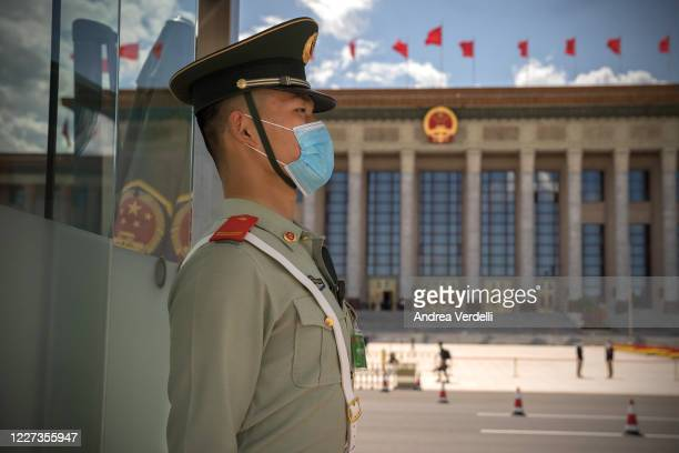 People's Liberation Army soldier stands guard in Tiananmen Square before the closing session of the Chinese People's Political Consultative...