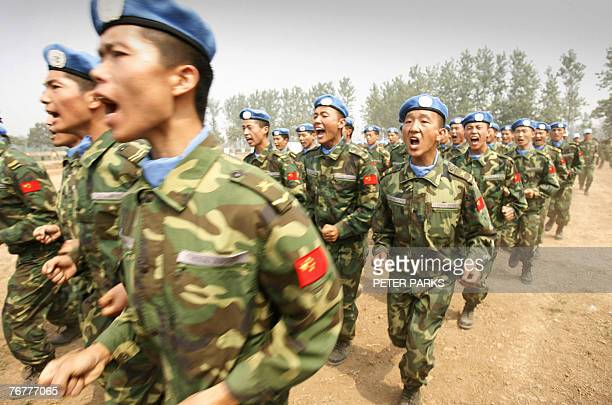 People's Liberation Army soldiers and members of a United Nations peacekeeping unit destined for Darfur in the Sudan train at their base in China's...