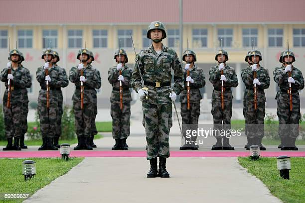 People's Liberation Army soldiers demontrate their skills during a reporting trip to the Third Guard Division of the PLA on July 28 2009 in Beijing...