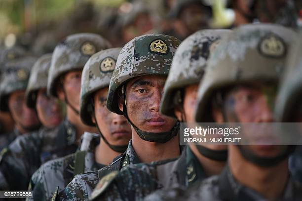 People's Liberation Army soldiers line up after participating in an antiterror drill during the Sixth IndiaChina Joint Training exercise 'Hand in...