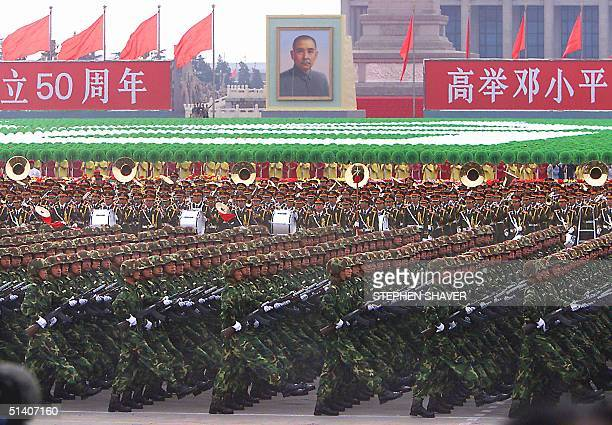 People's Liberation Army soldiers march past Chinese President Jiang Zemin and other top leaders during the massive 01 October 1999 national day...