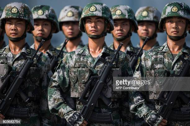 People's Liberation Army soldiers prepare for the arrival of China's President Xi Jinping at a barracks in Hong Kong on June 30 2017 Xi arrived in...