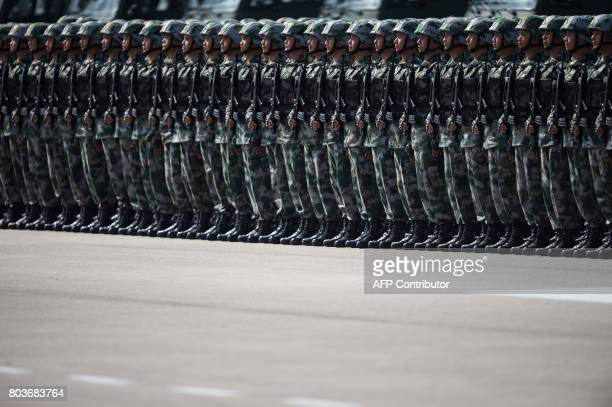 TOPSHOT People's Liberation Army soldiers prepare for the arrival of China's President Xi Jinping at a barracks in Hong Kong on June 30 2017 Xi...
