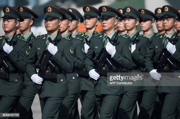 People's Liberation Army soldiers prepare for the arrival of China's President Xi Jinping at the Shek Kong barracks in Hong Kong on June 30 2017 Xi...