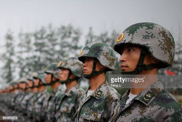 People's Liberation Army soldiers show their skills during a reporting trip to the Third Guard Division of the PLA on July 28 2009 in Beijing China...