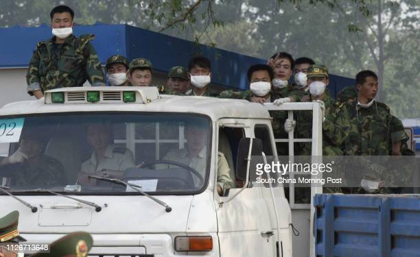 People's Liberation Army soldiers who have been helping in the construction leave the entrance of the Xiaotangshan hospital north of Beijing The...