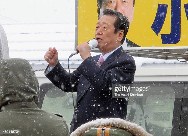 People's Life Party leader Ichiro Ozawa makes a street speech in the snow to call for support on December 6 2014 in Hanamaki Iwate Japan The focal...