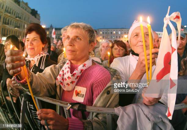 Peoples light candles during a mass prayer service on Sofia square in Kiev 28 September 2007 Ukraine's main parties staged final rallies Friday ahead...