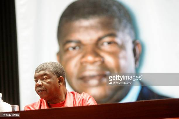 People's Movement for the Liberation of Angola presidential candidate and Angolan Defense Minister Joao Lourenco looks on during a meeting between...