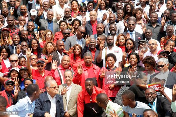 People's Movement for the Liberation of Angola presidential candidate Joao Lourenco gestures with other MPLA leaders during a presidential elections...