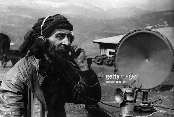 Peoples of the CaucasusCaucasian man listening to the radio Photographer PressClicheeMoskau Published by 'Tempo' 2Vintage property of ullstein bild