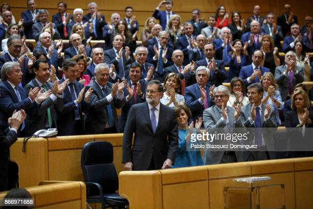 People's Party members applause to Spain's Prime Minister Mariano Rajoy after his speech during a plenary session to approve article 155 of the...