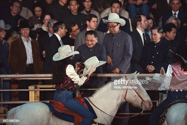 Peoples Republic of China leader Deng Xiaoping on a tour of the United States accepts a cowboy hat at a rodeo near Houston Texas 1979 He had...