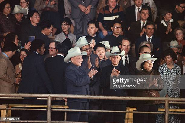 Peoples Republic of China leader Deng Xiaoping wearing a cowboy hat applauds at a Houston rodeo during a US State visit 1979