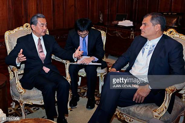 People's Republic of China's Minister of Foreign Affairs Wang Yi and Ecuadorean President Rafael Correa speak during a meeting at Carondelet...