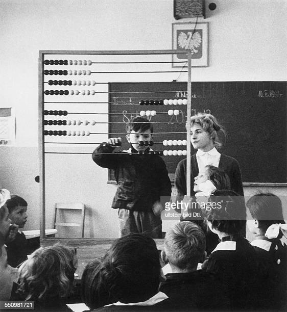People's Republic of Poland Lesson in a primary school in Wroclaw math lesson with abacus counting frame teacher Anna Bochenska