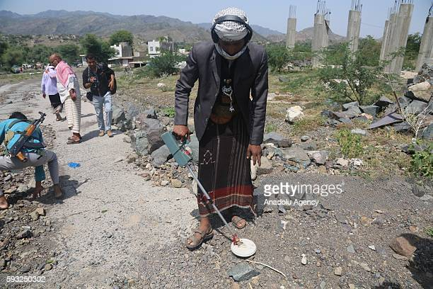 People's Resistance Forces loyal to President of Yemen Abd Rabbuh Mansur Hadi members remove mines after they took control of Souq Al Dabab district...