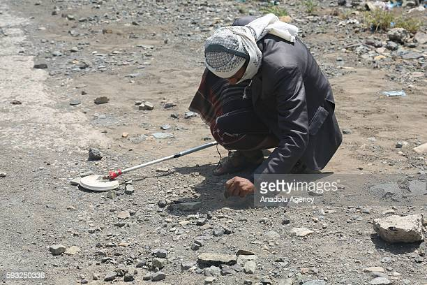 People's Resistance Forces loyal to President of Yemen Abd Rabbuh Mansur Hadi member removes mine after they took control of Souq Al Dabab district...