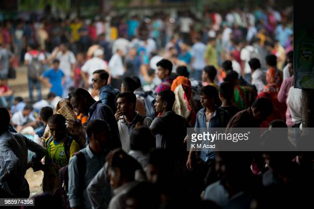 Peoples travel by train as they going their home to be with their families ahead of the Muslim festival of Eid al-Fitr, in Dhaka. Eid al-Fitr, the...