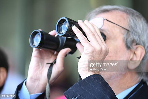 Peoples use binoculars during the Horse Racing Qatar Prix de l'Arc de Triomphe on October 2 2016 in Chantilly France