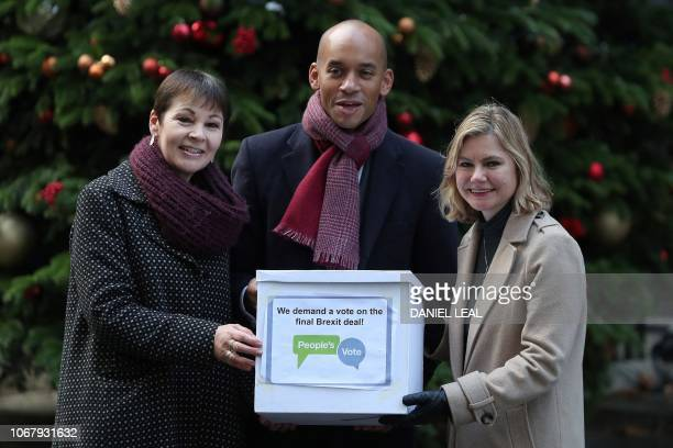 People's Vote campaigners British politicians Green party MP Caroline Lucas Labour Party MP Chuka Umunna and Conservative MP Justine Greening deliver...