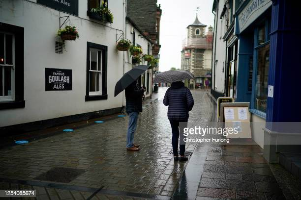 Peopleshop in Keswick town centre on July 03, 2020 Keswick, United Kingdom. Despite a gloomy weather forecast by the MET office, England's Lake...