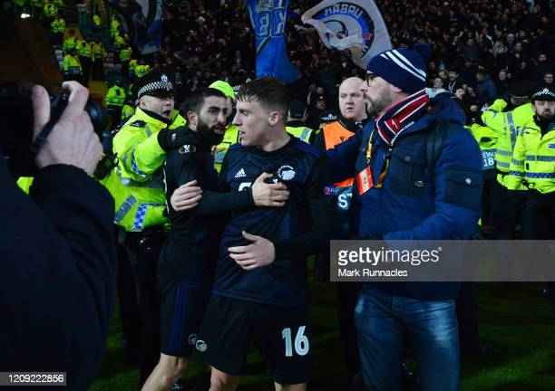 Pep Biel and Micheal Santos of FC Kobenhavn clash with officers from Police Scotland as Pep Biel celebrates his goal and a police officer is knocked...