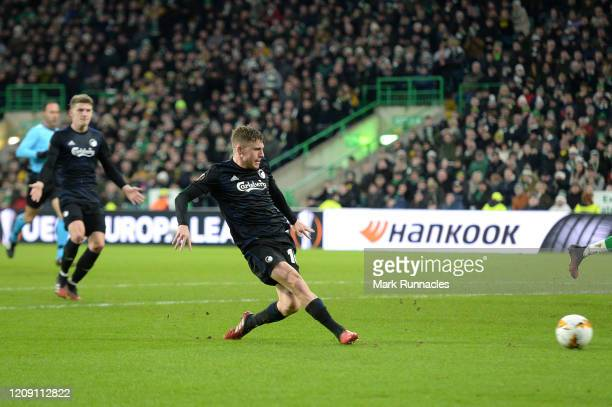 Pep Biel of FC Copenhagen scores his sides second goal during the UEFA Europa League round of 32 second leg match between Celtic FC and FC Kobenhavn...