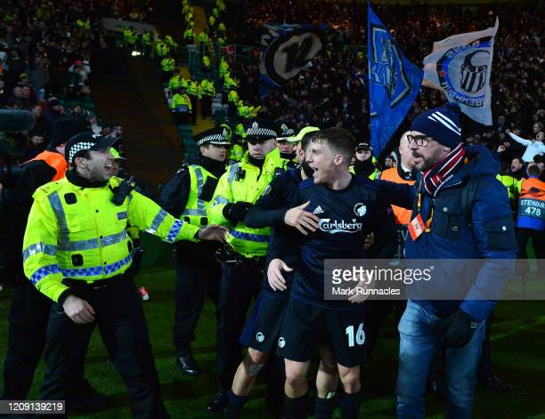 Pep Biel of FC Kobenhavn is held back by officers from Police Scotland as he tries to celebrate his goal with the Kobenhavn fans during the UEFA...
