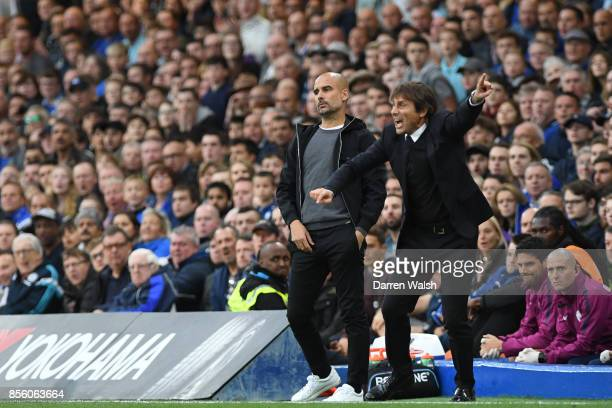 Pep Guardiola and Antonio Conte Manager of Chelsea during the Premier League match between Chelsea and Manchester City at Stamford Bridge on...