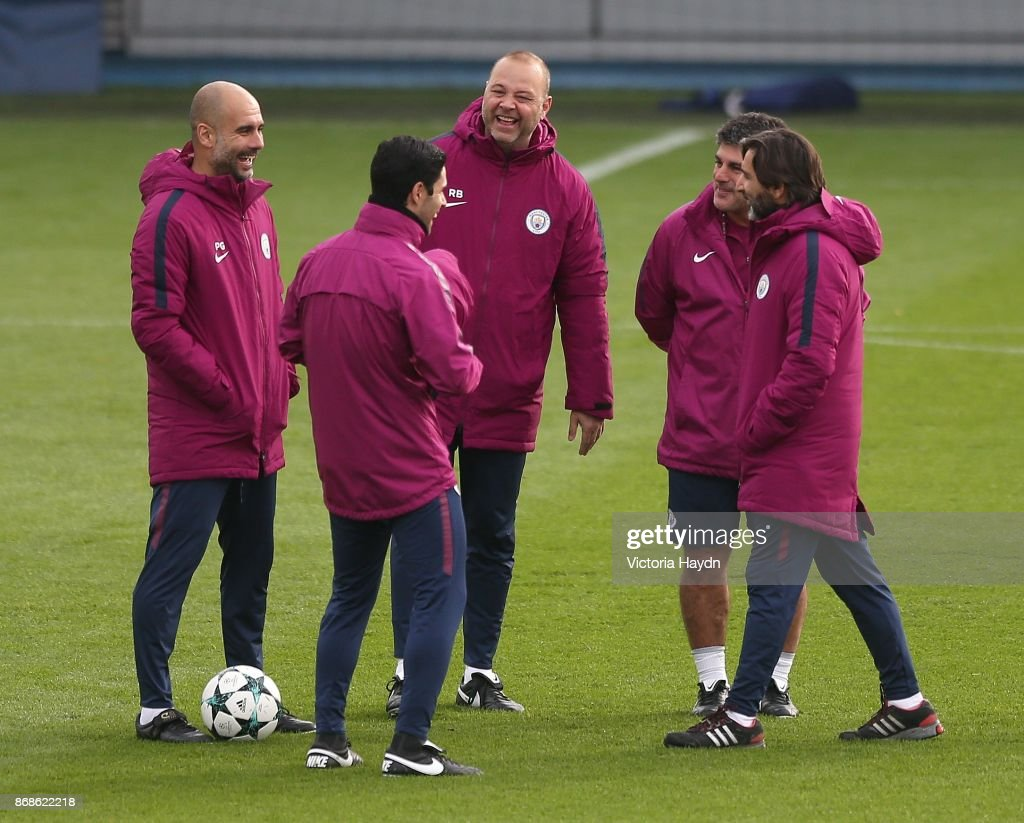 Pep Guardiola and staff reacts during training at Manchester City Football Academy on October 31, 2017 in Manchester, England.