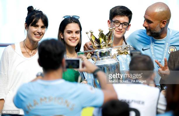 Pep Guardiola celebrates with the trophy and wife Cristina Serra and family