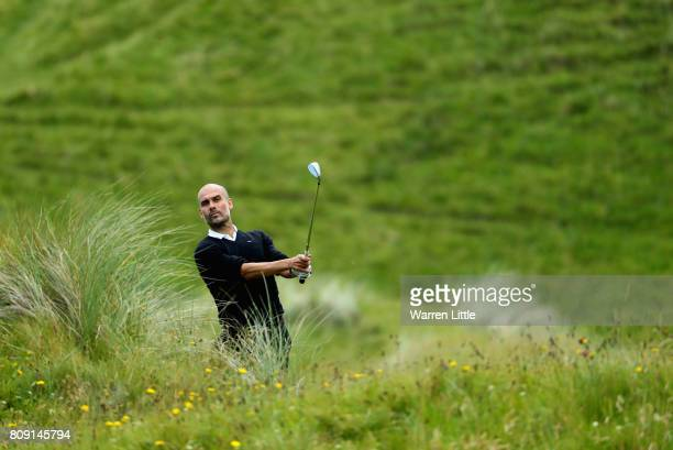 Pep Guardiola chips onto the 1st green during the ProAm of the Dubai Duty Free Irish Open at Portstewart Golf Club on July 5 2017 in Londonderry...