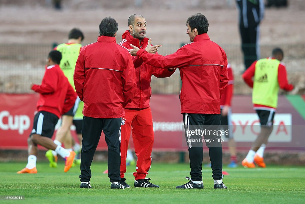Pep Guardiola, coach of Bayern Muenchen gives instructions during a training session outside the Agadir Stadium on December 16, 2013 in Agadir, Morocco.