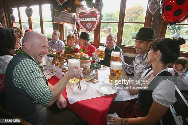 Pep Guardiola head coach of Bayern Muenchen attends with his wife Cristina Serra KarlHeinz Rummenigge CEO of Bayern Muenchen and Matthias Sammer...