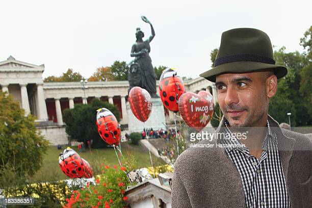 Pep Guardiola head coach of Bayern Muenchen looks on in front of the ensemble of the Bavaria statue a monumental bronze sandcast 19thcentury statue...