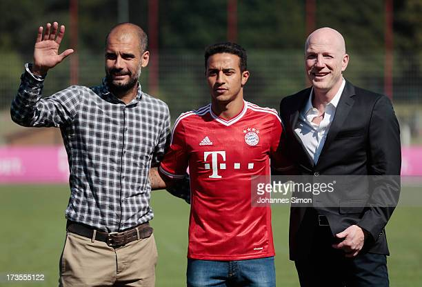 Pep Guardiola head coach of FC Bayern Muechen and sporting director Matthias Sammer present new recruit Thiago Alcantara after a press conference at...